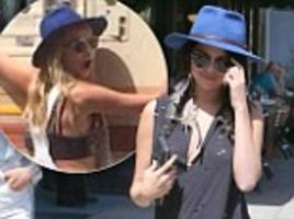 Cara Delevingne wears new BFF Selena Gomez's eye-catching fedora as she sightsees in LA