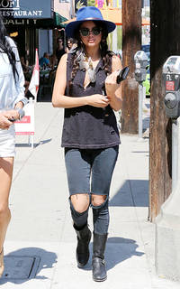 Selena Gomez wears funky blue fedora and ripped jeans on a casual walk around LA - Love or Loathe?